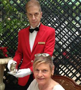 A waiter in the Winter Garden conservatory (note the white gloves)