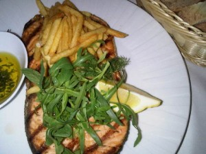 Fish and chips in Baku may well mean a large salmon steak, perfectly cooked, with shoestring fries and a herb salad