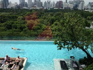 The pool seems cantilevered over Lumphini Park