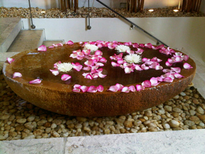 Water continuously trickles from a calming bath at the entrance to the spa