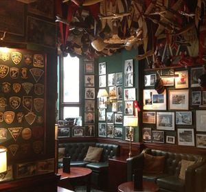 .. inside, connecting rooms are a cornucopia of overhead and wall-hung memorabilia