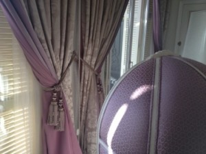 The beautiful curtains, and tall chair, in suite 062/063