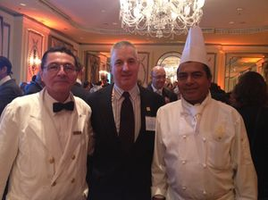 Heiko Kuenstle flanked by two colleagues during a Leading lunch