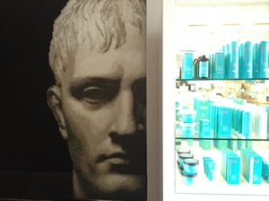 A Roman head next to spa products