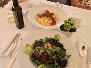 Stylish, salad and penne carbonnara at the Adlon