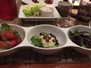 A trio of starters (with fat-and-crudités behind)