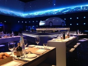 A courtyard turned into a covered restaurant, for a car launch dinner-for-450