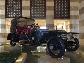 A 1911 Rolls sits above a decorative pool in the lobby