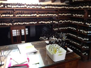 A thousand-plus bottles, in alphabetical order, line his office