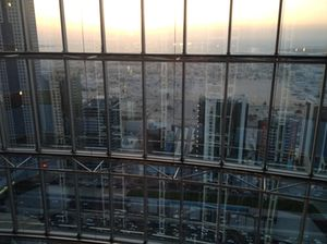View through a rising elevator, early evening
