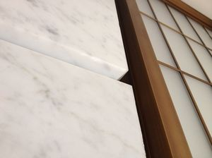 Bevelled edges to Portland stone wall panels