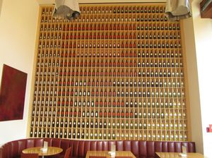A wall of 504 wine bottles, with reds forming an R