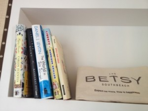 Book bag, and one of the bookshelves, in suite 223