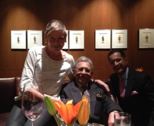 Mr Oberoi, centre, with his son Vikram