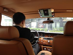 Arrival in a leather-lined Rolls-Royce