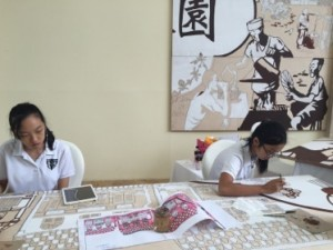 Artists at work, daily, in the lobby