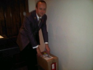 Edmund, concierge at Brown's Hotel, London, brings out the box containing my new Porsche Design Rimowa suitcase