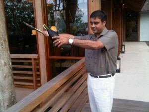 Vikram Singh cuts the top off the bottle with his sabre sword - datai - langkawi