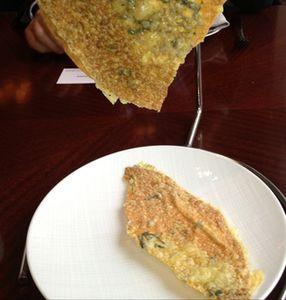 Breaking bread, to the plate below..