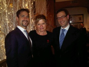 Mark (left) and Philipp Mosimann flank Mary Gostelow