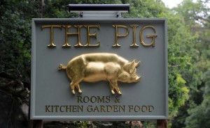 A golden pig sign at the entrace of The Pig, an ultra-expensive country resort