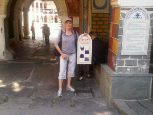 At the entrance of Rila Monastery, wearing cover-up