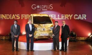 Ratan Tata displays his gold Nano
