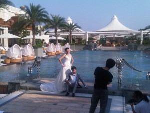 Luxury hotels and travel -  couple by the pool of Banyan Tree Macau