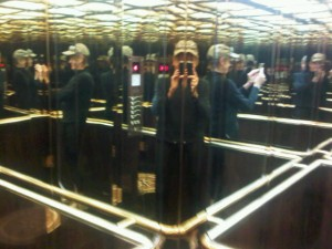 Luxury hotels and travel - try photographing in an all-mirrored elevator!