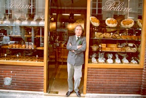 Luxury hotels and travel - Lionel Poilâne stands at his shop door