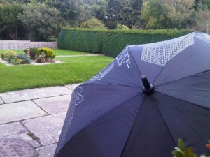 Luxury hotels and travel - A well-travelled oversized umbrella