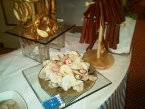 Bavarian breakfast items, würst, radish slivers and pretzel