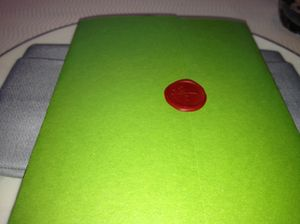 At 16, places are set with sealed green menus