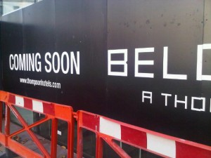 A sign announces the forthcoming Belgraves hotel