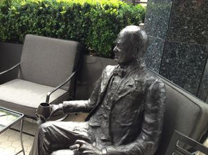 Lifesize statue of Churchill in the leafy outdoor terrace...