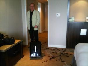 Shangri-La's General Manger, Franz Danhauser, no less, wheels the suitcase into room 2811