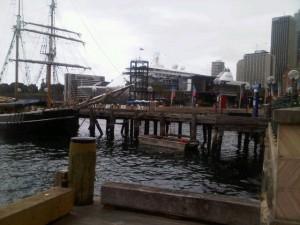 Walking along the boardwalk to Park Hyatt Sydney, past a mass of masts