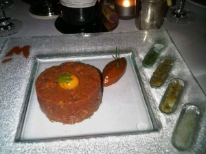 Mosimann's steak tartare, topped by a quail's egg