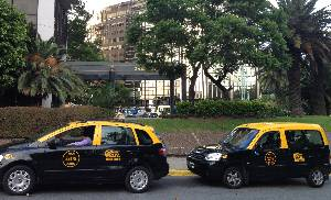 Many say avoid the black and yellow taxi cabs
