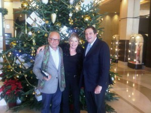Wolf Hengst (left), Richard Schilling and the Martinez Christmas tree