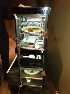 A tall tiered trolley transports dinner in the room