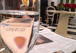 Waiting for your power- breakfast companion, with a glass of water and today's news