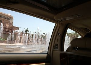 Palace fountains seen from a Maybach