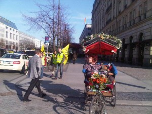 Outside the Adlon Kempinski, the winter sunshine brought out rickshaws and protesters
