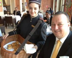 Adlon's GM Oliver Eller and a croissant dispenser