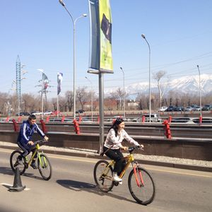 Local cyclists (snow-capped mountains behind)