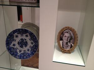 Delft next to a photo of former-Queen Beatrix