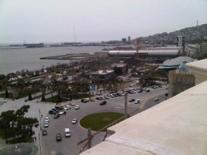 View from Four Seasons Baku rooftop, showing the forthcoming carpet museum (like a rolled carpet) and, by the post at the far left of picture, the venue of Eurovision 2012