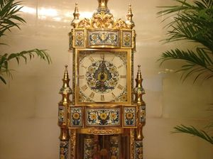 Antique clock by elevators