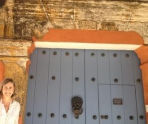 Carmen Otero shows off an historic door
